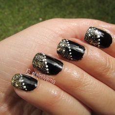 Gold glitter nail art design.