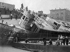 The Eastland ship being righted after the disaster on the Chicago River, 1915.