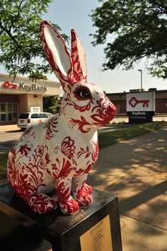 """Garden Party"" by Laurie Musser. Sponsored by Key Bank. Photo by Tony Barchock.  In honor of the Chinese Year of the Rabbit, the St Clair Superior Development Corporation put together a public art campaign in the city of Cleveland, OH. Local artists decorated 25 fiberglass rabbit sculptures which were installed in key locations throughout the city."