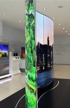 LG's double-sided TV is a 111- inch screen made of three 65-inch Ultra HD OLED displays and allows two viewers to watch different sides of the television simultaneously