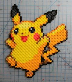 Pixellated sprite with the use of Hammas beads. Generated sprited with beads would be reasonable as it gives off that nostalgic 8-bit feel