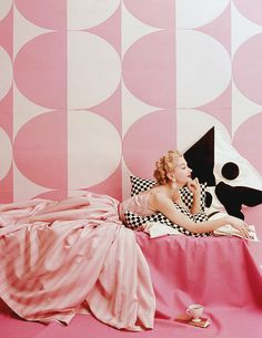 """Lisa Fonssagrives in """"Spice Pinks to Summer In,"""" photographed by Richard Rutledge, Vogue, April 15, 1952 (via)"""