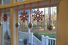Tension Rod to hang ornaments in a window! Brilliant!!  http://lorimayinteriors.com/blog/