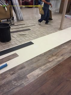 Our installers putting a luxury vinyl plank down using a floating installation. Using the pad underneath it goes right over the old ceramic tile that you can see was a very busy pattern without the worry of it showing through!
