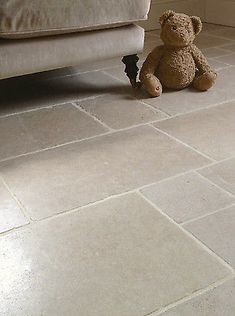 The stone has a warm creamy grey ground with subtle warm tones and occasional small pearlescent fossils are a feature. With it& tumbled edge and a lightly honed surface, it is an excellent choice for an aged flagstone look. Hall Flooring, Basement Flooring, Porch Flooring Tiles, Modern Flooring, Unique Flooring, Flagstone Flooring, Limestone Flooring, Kitchen Tiles, Kitchen Flooring