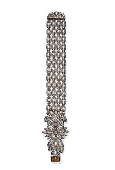 A rare 18th century diamond Golden Fleece bracelet. Designed as an old-cut diamond neck badge of the Austrian Order of the Golden Fleece to four rows of old-cut diamond oval links to the three- line diamond clasp, closed back setting, mounted in silver and gold, circa 1770. Provenance: The von Thurn und Taxis Family.
