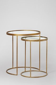 Stand out nesting tables in brass and glass finish. Art Deco Luxe style for your living room. Beautiful side tables.