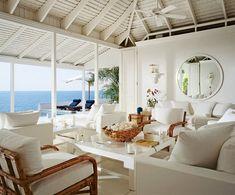 Ralph & Ricky Lauren's idyllic home on Jamaica:  Marble floors were installed in the living room. Hurricane lamps, Ralph Lauren Home.
