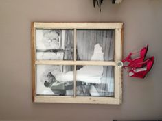 Picture from wedding with wedding shoes hanging on old glass door knob.