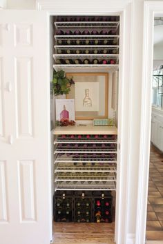 Check out this coat closet turned wine closet using elfa!! | Be Simply Organized