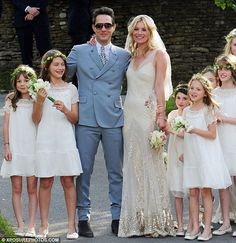 Kate Moss in vintage-ey glam wedding dress. She's always so effortlessly cool.