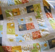 This is one of the most adorably baby quilt ideas for baby boy quilts! For the Storytime Squares Baby Quilt, cut squares of printed fabric featuring your little guys' favorite stories and then arrange them in a concentric pattern.