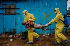 young ebola victim carried away by medical workers in Monrovia