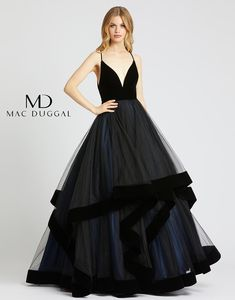 Look daring in this black ballgown with navy underlay that creates the perfect dramatic look! Style has velvet ruffled edges, a velvet bodice, spaghetti straps, and plunging v-neckline. Plus Size Evening Gown, Evening Dresses, Gowns Of Elegance, Elegant Gowns, Formal Gowns, Beautiful Evening Gowns, Online Dress Shopping, Shopping Sites, Mac Duggal