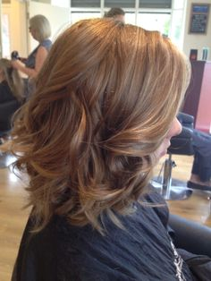 Colour by louise at belle amie beautiful subtle blonde highlights through light brown bob with curls