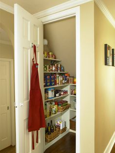 Establish an Efficient Pantry | Convert the space under the staircase into a small room for storing food, paper goods, and extra cooking equipment. Add a door and wrap the three walls with shallow shelves.
