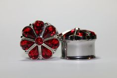 Absolutely stunning plugs! These are so pretty. In this silver metalized plastic setting, are 7 red teardrop shaped rhinestones, with a smaller