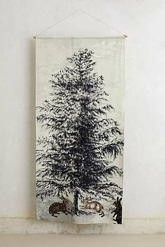 Christmas tree inspiration (Landon is allergic to real ones!) // Anthropologie - Northern Pine Wall Tapestry
