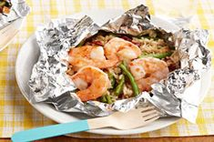 Backyard Shrimp & Rice Bundles – A zesty mix of green beans, rice and sun-dried tomatoes is bundled with shrimp in foil packets on the grill for a tasty dish with easy cleanup.