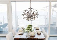 kind of interesting.... Crystorama lighting solaris 5 light 22'' wrought iron chandelier globe
