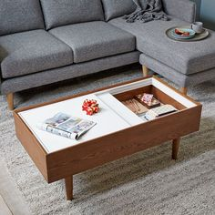 Smart, streamlined style. The top of our Double Storage Coffee Table slides open to reveal storage space below. It's great for hiding remotes, magazines or extra blankets.