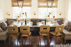 """In this L.A. dining room, designer Peter Dunham fashioned a sprawling yet comfy corner. """"A deep banquette in a dining area is dressier and more relaxed than just chairs,"""" he says. He brightened it with six pillows made from a vintage suzani from Design Utopia. Banquette not in the budget? Pull in an armchair from another room or try tossing a few pillows onto the seating. Victoria Pearson  - HouseBeautiful.com"""