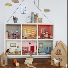 Doll house made from an old decorated bookshelf :)