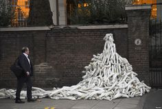 Piles of mannequin limbs are seen outside the Russian embassy in London - they are part of a protest against military action in Syria.