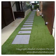 Stones steps set amidst an artificial turf strip