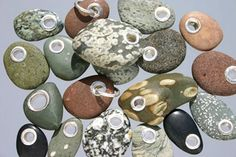 Beach rocks, drilled and stacked onto a rod and used as hose guides. by Coffee Miklos