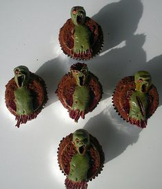 Awesomely Disgusting!! Think I found the zombie cupcake design for Kalebs zombie party :-)
