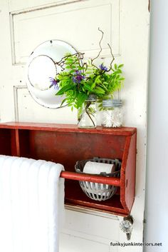 Toolbox turned towel holder / Bathroom storage ideas in Cabin Life! on FunkyJunkInterior...