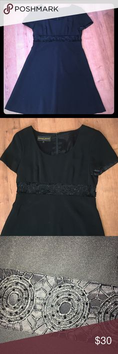 Perfect little black dress from Donador Ricco Perfect little black dress from Donador Ricco. Beautiful decoration all-around address below the bust area. Perfect for an evening out or an event. Size 4 Donna Ricco Dresses