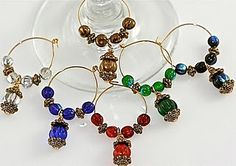 When you're ready to throw your next Christmas bash, get the party started with these Beaded Wine Charms. Your holiday guests will be sure to fall in love with this free Christmas craft. Wine Bottle Corks, Wine Bottle Crafts, Beaded Christmas Ornaments, Christmas Crafts, Christmas Ideas, Christmas Tree, Wine Down, Painted Wine Glasses, Wine Glass Charms