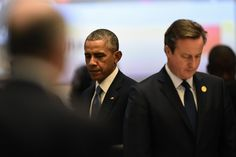 U.S. President Barack Obama (left) and British Prime Minister David Cameron observe a minute of silence on November 15, 2015 to remember the victims of ...