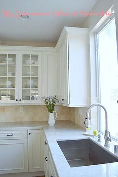 Kitchen updates including new farmhouse sink, faucet and countertops