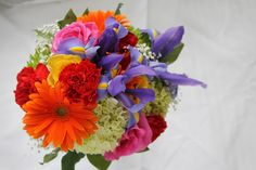 Bridesmaid Bouquet of Orange Gerbera Daisy, Green Hydrangea, Purple Iris, Pink Attaché  Roses, Red Carnations, Yellow Roses and Greens