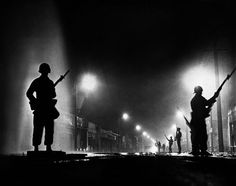 Watts Riots, August National Guard troops secure a stretch of Street, dubbed Charcoal Alley, to help Los Angeles authorities restore order. Armed Security Guard, Security Guard Companies, Watts Riots, Joining The Police, Visit Texas, Award Winning Photography, Today In History, Remember The Time, Afraid Of The Dark