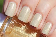 Essie - As Gold as it Gets top coat over a nude.  I'm really digging the Essie LuxeEffects topcoats.  Cool stuff.