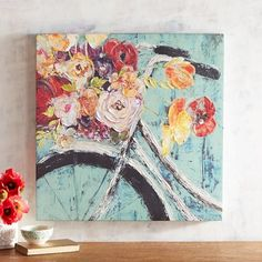 Who knew a bicycle could grow flowers? Our colorful canvas painting, both playful and pretty, will make you smile each time you walk by it. Hang it in a prominent place on your bedroom, family room or entryway wall.