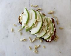 Ezekial bread topped with Hood cottage cheese (pear and honey), sliced pear, and slivered almonds