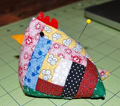 Such a cute, log-cabin chicken!  This cute little pincushion was made for me by a lady in our sewing group at church - it's completely hand pieced and made out of tiny log cabin blocks. It's not very big - just about the size of a real baby chick! Isn't it adorable?