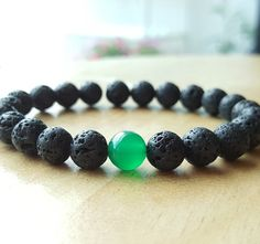 Check out this item in my Etsy shop https://www.etsy.com/listing/294672925/lava-stone-bracelets-green-agate-energy