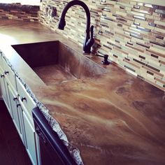 Concrete countertop stained with a matte finish and chiseled stone edge