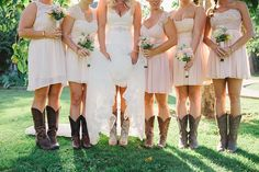 The bride and her bridesmaids in pink and cowboy boots