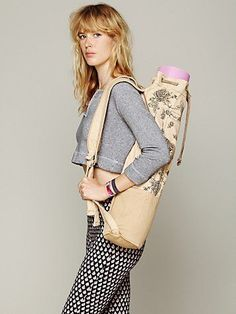 Cobra Yoga Bag | Printed canvas yoga bag with two large outside pockets. Suede drawstring closure at top opening. Adjustable shoulder straps. This bag can be worn as a back pack, or slung over one shoulder. Inside has one zipper pocket.   *By Free People
