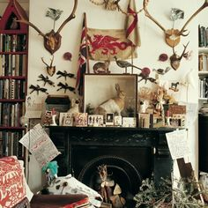 Illustrator Mark Hearld's York, UK home - fireplace with abundance of taxidermy, animals and antlers.