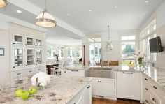"""Warm white!! That'd it! CJ  Alaska White granite counters  """"Warm white""""  Alaska White granite counters look a bit like marble — enhance the richness by painting cabinets and walls the same warm off-white hue. Pristine white ceilings keep the space feeling open, and pendant lights add to the elegant feel."""