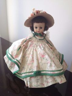 """Up for auction is a SUPER RARE 1955 Madame Alexander Scarlett #485 SLW. She is listed on page 162 of WOA and was made for one year only. She is absolutely stunning. She is wearing her two tiered pink rosebud dress with green rick rack and has a crinoline skirt. Her straw hat is beautiful with tiny flowers adorning the crown. She is tagged """"Alexanderkins"""", and also has her original pantaloons and shoes and socks. She comes from a smoke free home. Please email me with any quest..."""