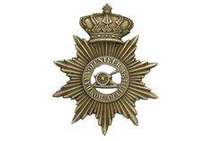 Badge. Indian Army. Bombay Volunteer Artillery Victorian helmet plate. Good scarce die-stamped wh